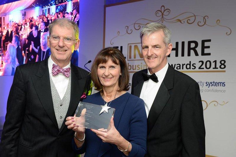 Paul Crudge and Karen Newbury receiving two Flintshire business awards