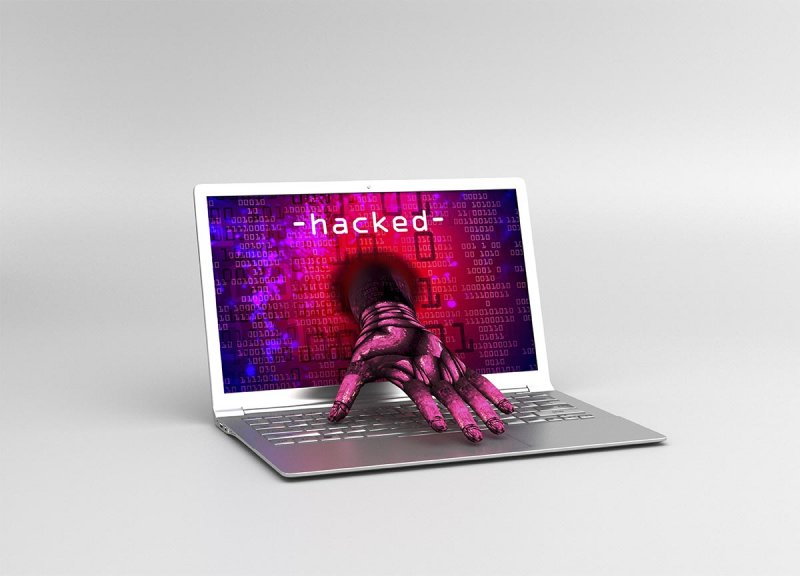 Zombie hacker attack hand coming out of laptop pc