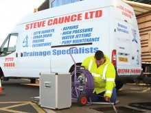 Steve Caunce van and engineer at work