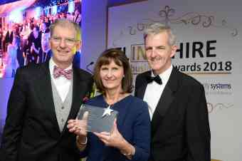 Paul Crudge and Karen Newbury receiving two Flintshire business awards